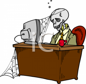 205_skeleton_at_a_dead_end_job_with_cob_webs_forming_on_it_and_the_computer_he_was_stuck_at